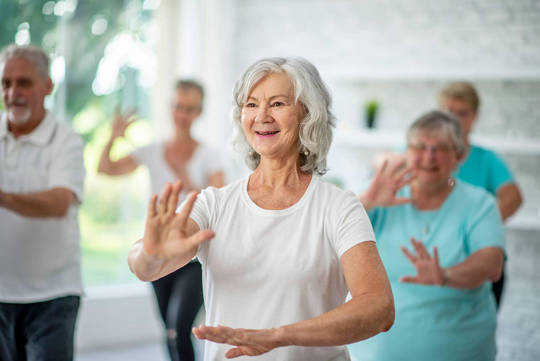 Senior woman practicing yoga inside