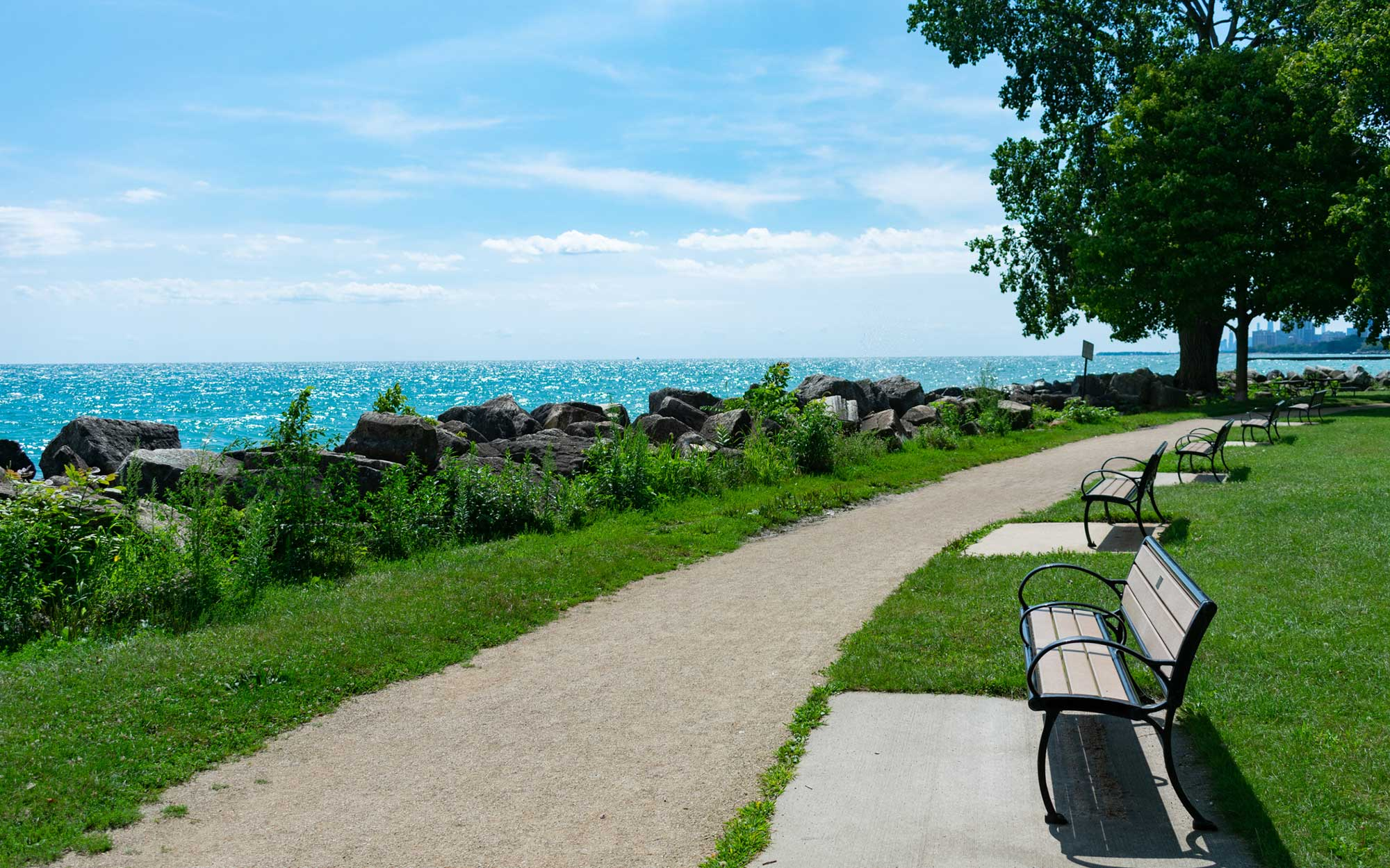 Evanston park with benches and Michigan river