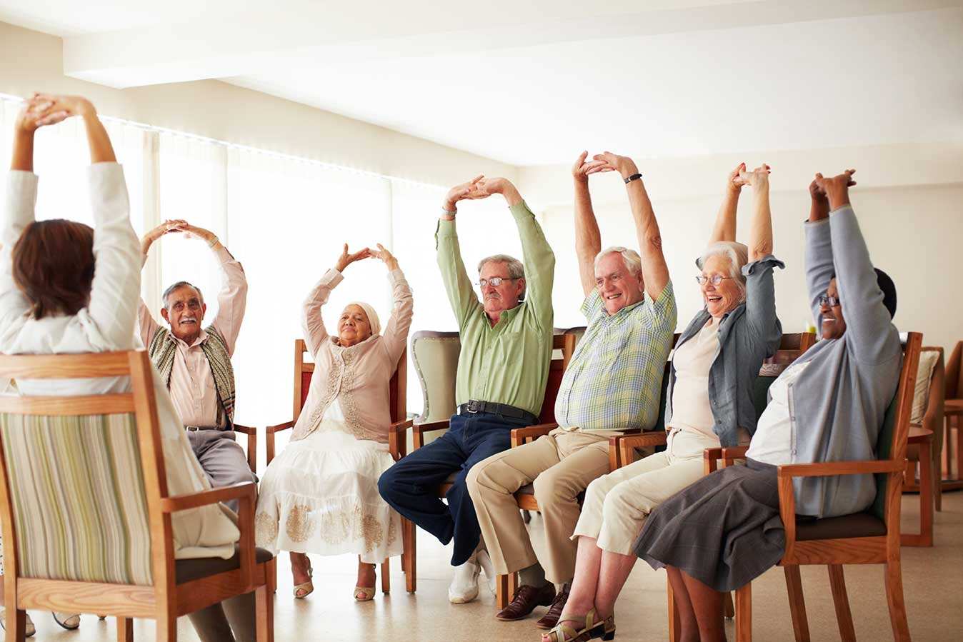 Senior group in a wellness class stretching
